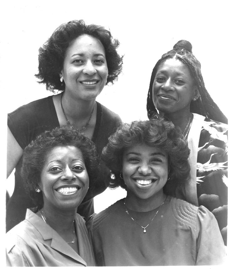 Uptown String Quartet, 1983.  Pictured (clockwise from left): Maxine Roach (viola), Akua Dixon (cello), Cecelia Hobbs (violin 2), Gayle Dixon (violin 1).  Photo by Chuck Stewart.  Publicity shot taken for first European tour of the Max Roach Double Quartet/ Uptown String Quartet, which included 28 critically-acclaimed performances in eight countries:  Austria, Switzerland, Italy, Germany, Noway, Finland, Denmark, and Spain.