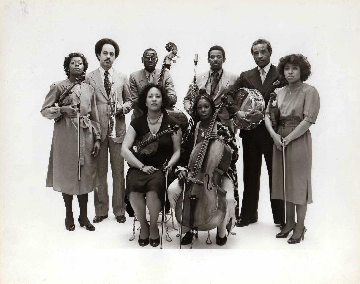 Max Roach Double Quartet, 1983:  (clockwise from left)  Gayle Dixon (violin 1), Cecil Bridgewater (trumpet), Calvin Hill (bass), Odean Pope (saxophone), Max Roach (drums), Cecelia Hobbs (violin 2), Akua Dixon (cello), Maxine Roach (viola).  Photo by Chuck Stewart